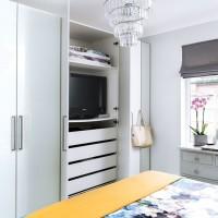 Grey modern bedroom with modular wardrobe storage