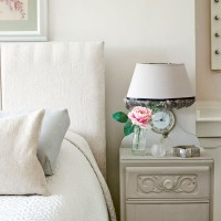 White classic bedroom with bedside table and lamp with built-in clock