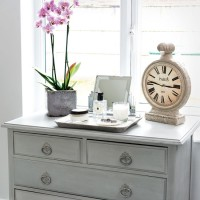 Traditional bedroom with painted chest of drawers and pretty display