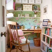 Compact country home office with floral wallpaper