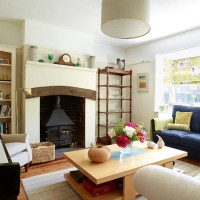 Country living room with indigo sofa and centrepiece coffee table