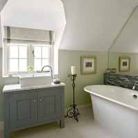 Traditional bathroom with green walls and vanity unit