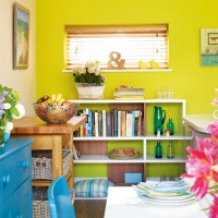 Kitchen diner with zingy lime feature wall and blue furniture