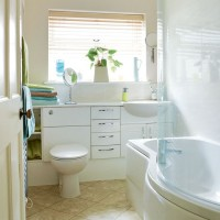 Chic compact bathroom with shower bath and fitted units