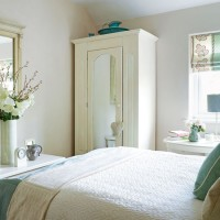 Neutral bedroom with glamorous details and touches of blue