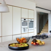 White kitchen with handleless units and built-in appliances