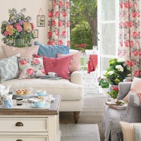 Summer living room with floral curtains and cushions