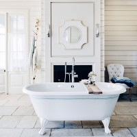 Traditional bathroom with classic roll-top bath and birch branch