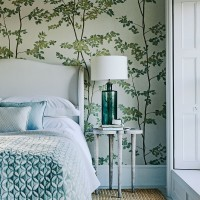 Whimsical bedroom with botanical wallpaper and side table