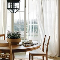 Classic dining room with wooden dining set and pendant light