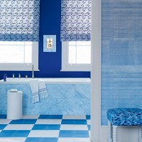 Blue bathroom with chequered flooring and patterned blinds