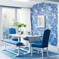 Blue dining room with floral wallpaper and white dining table
