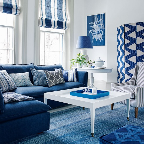 Blue And White Living Room With Cobalt Blue Sofa And Striped Blinds
