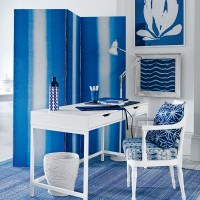 Modern home office with blue screen and white desk