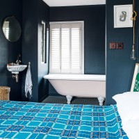 Deep blue bedroom with en-suite bathroom alcove