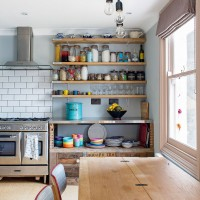 Industrial-style kitchen with tea chest storage and extendable table