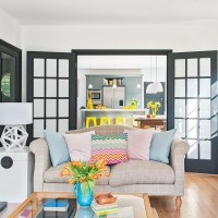 Modern living room with country-style sofa and black glazed doors