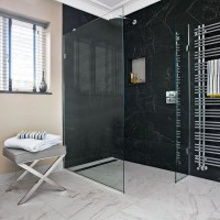 Modern bathroom with marble-effect tiles and shower enclosure