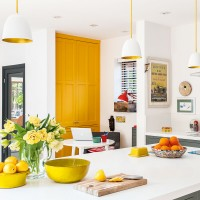 Modern kitchen-diner with yellow accents and white walls