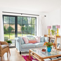 Smart living room with colourful accessories and wooden furniture