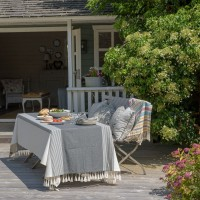 Smart garden table and bench dressed with cloths and throws