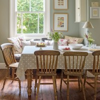Country-house dining room with wooden chairs and bench