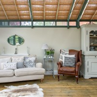 Conservatory seating area with smart roof blinds