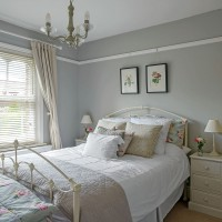 Mid grey bedroom with neutral contrasts and red rose accents