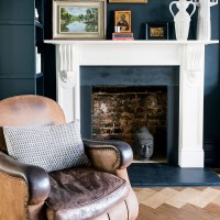 Navy blue living room with stone fire surround