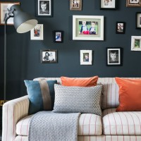 Navy blue living room with photo wall and floor lamp