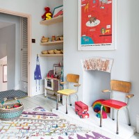 Children's bedroom with bright accessories and alcove shelving