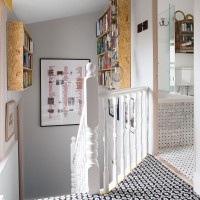 Grey hallway and landing with patterned carpet