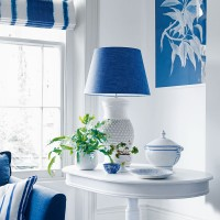 Blue-and-white hallway with side table and indigo lampshade
