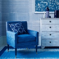 Painterly blue living room with armchair and abstract print