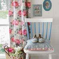 Shabby-chic hallway with floral curtain and painted chair