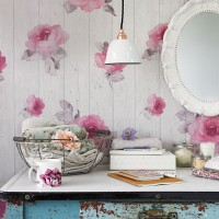 Shabby-chic bedroom with dressing table and floral wallpaper