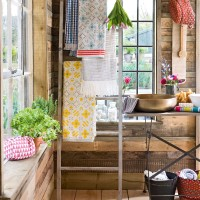Country-style bathroom with vibrant towels and ladder storage
