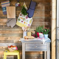 Country kitchen with wooden panelling and vibrant accessories
