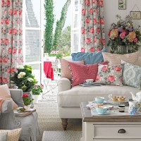 Shabby-chic living room with floral curtains and patterned cushions