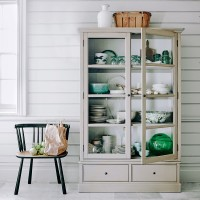 Pared-back country kitchen with dresser and crockery