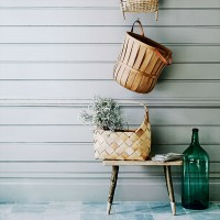 Pared-back country utility room with woven storage baskets