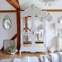 Luxurious bedroom with French-style mirrored wardrobe