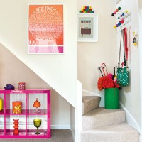 Compact hallway with stairwell storage and under-stairs display