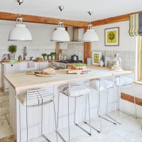 Country kitchen with island unit and pendant lighting