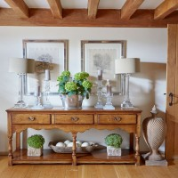 Country hallway with wooden console table and matching lamps