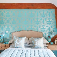 Country-style bedroom with turquoise feature wall