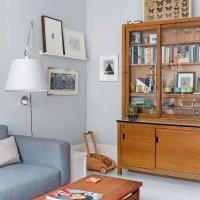 Modern living room with glass door cabinet