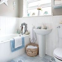 Grey-walled bathroom with blue-and-white floor tiles