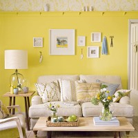 Primrose yellow living room with pared-back furniture