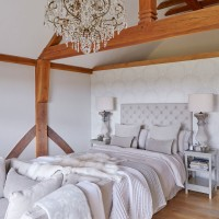 Country bedroom with glamorous chandelier
